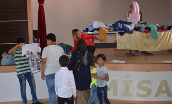 Türkoğlu Belediyesi'nden Yetim Çocuklara Giyim Yardımı