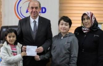 İlkokul Öğrencisi İki Kardeş Harçlıklarını Depremzedelere Bağışladı